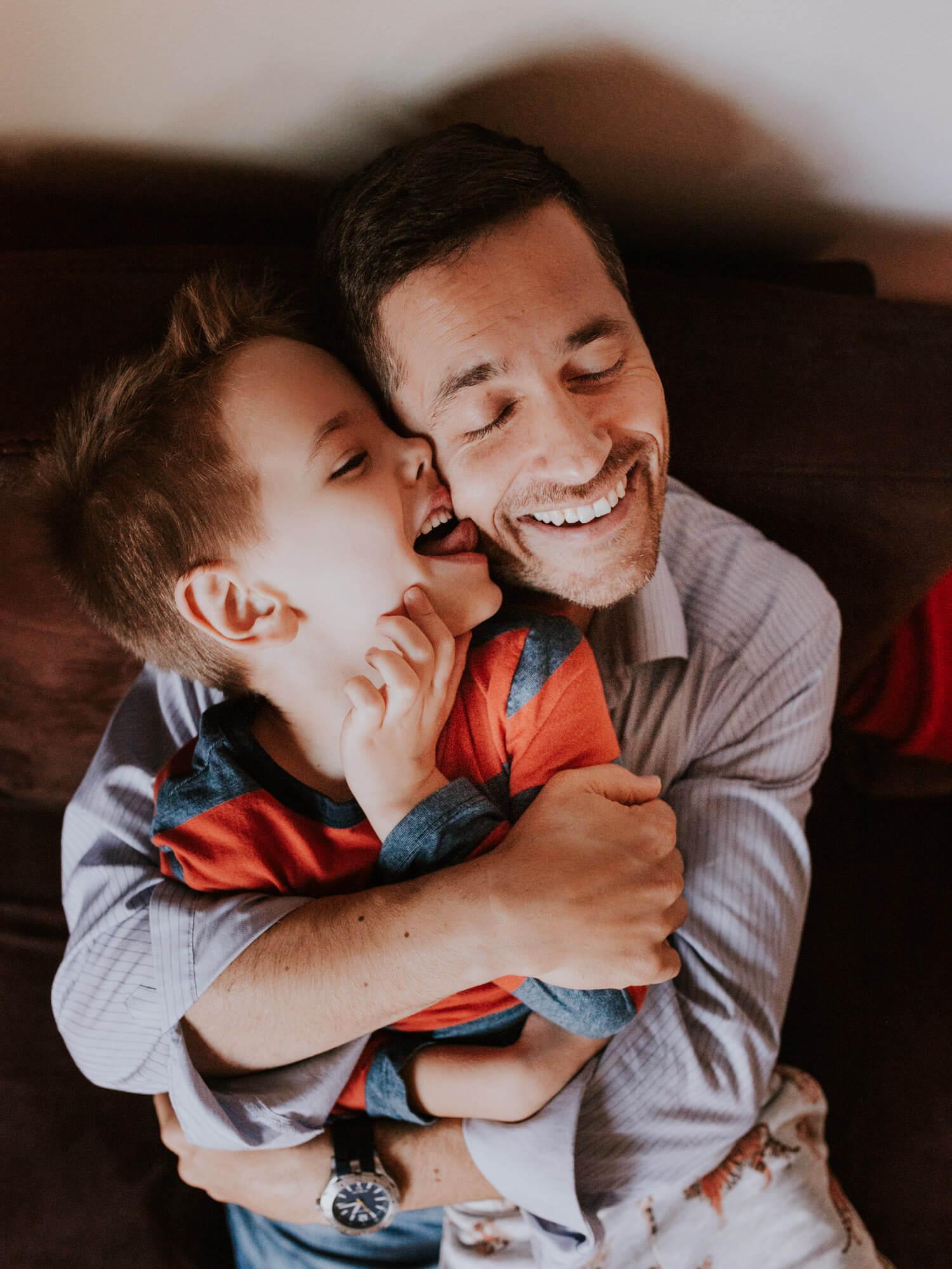 hug father and son lick cheek family